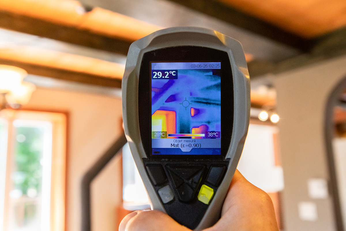 An Infrared, thermal imaging device being used while preforming home inspection services